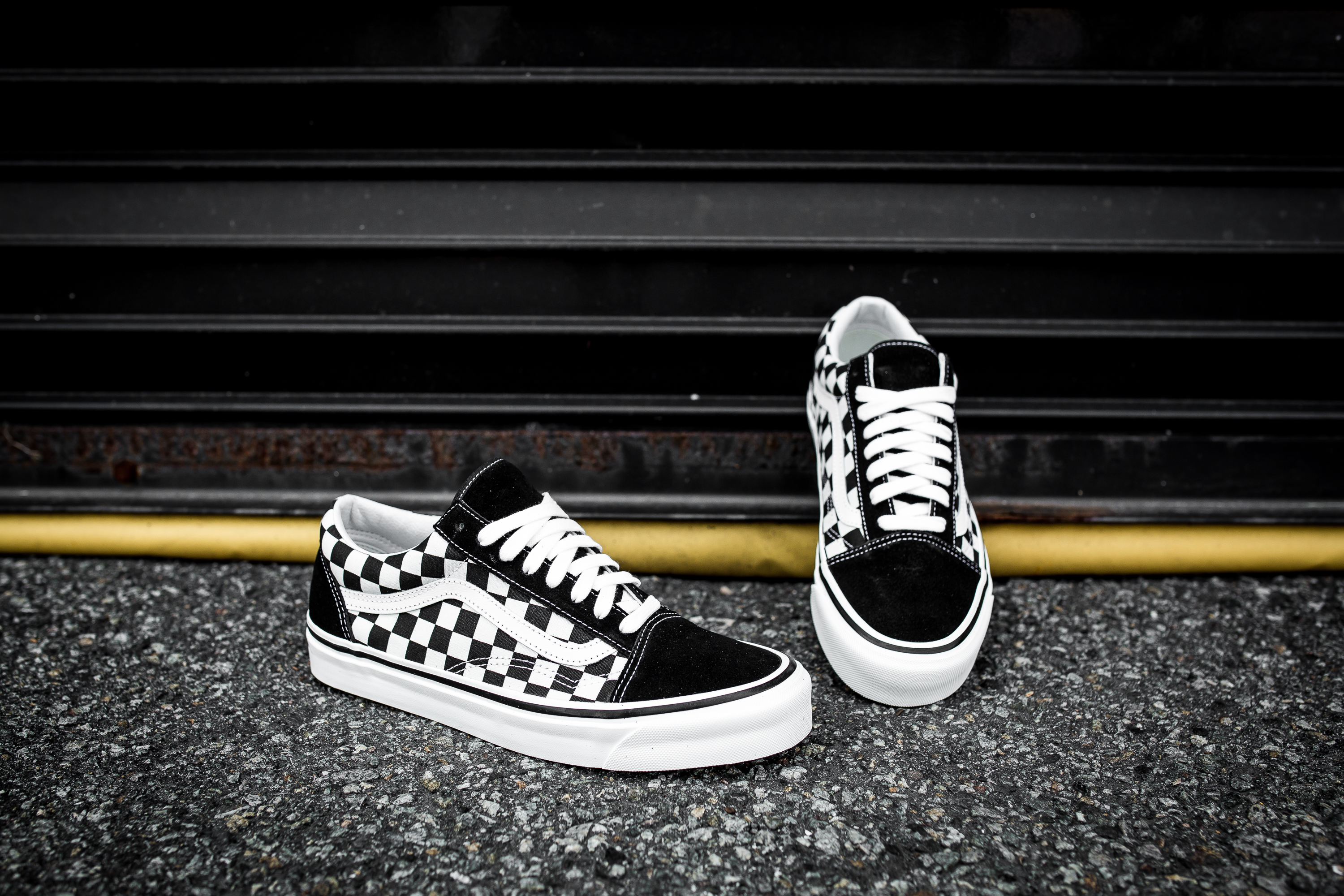 checkerboard vans on feet